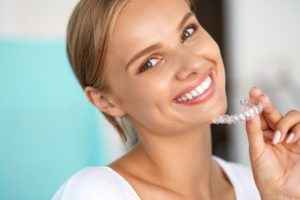 Woman smiling with Invisalign.